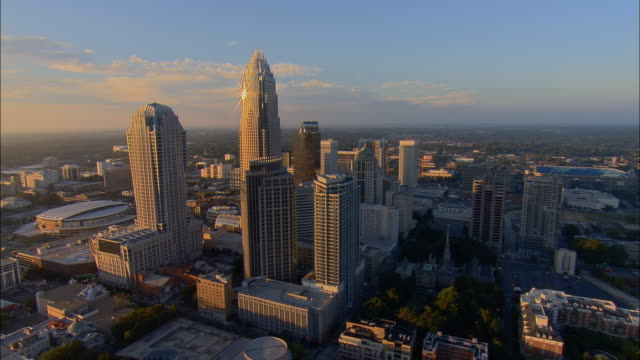 aerial ws circling around bank of america corporate center and downtown cityscape at sunrise / charlotte, north carolina, usa - charlotte north carolina stock videos & royalty-free footage