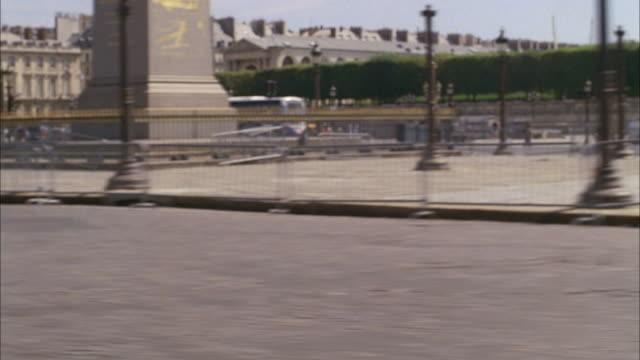 POV Circling through Place de la Concorde, passing the fountain and the Luxor Obelisk's base / Paris, France
