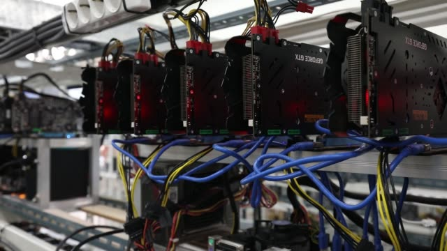 stockvideo's en b-roll-footage met circuit boards sit on shelves at a cryptocurrency mining facility in incheon south korea on friday dec 15 the bitcoin symbol is displayed on a power... - incheon
