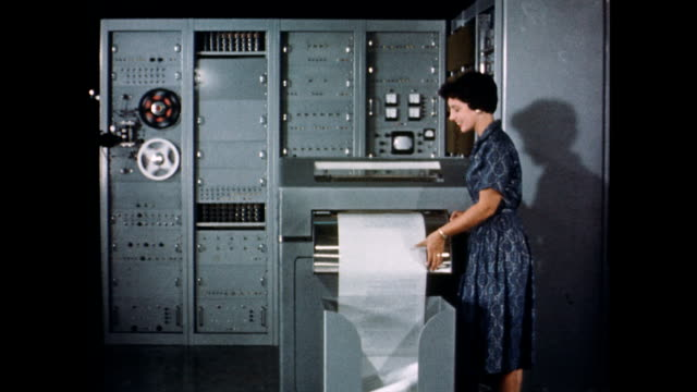 CU circuitry of translation machine / woman inspects translation machine printout Inside a Russian translation machine on September 01 1959
