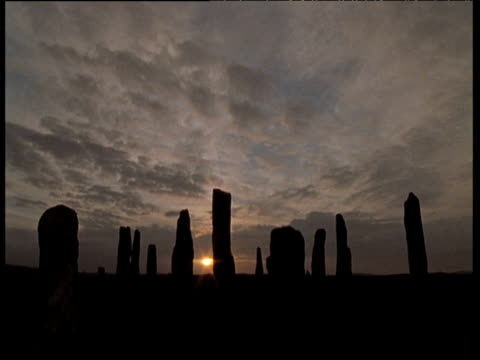 circular callanish standing stones in silhouette at sunset, outer hebrides - hebrides stock videos & royalty-free footage