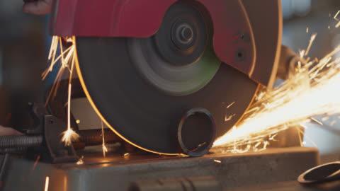 cu circular saw cutting metal emits sparks - rohmaterial stock-videos und b-roll-filmmaterial