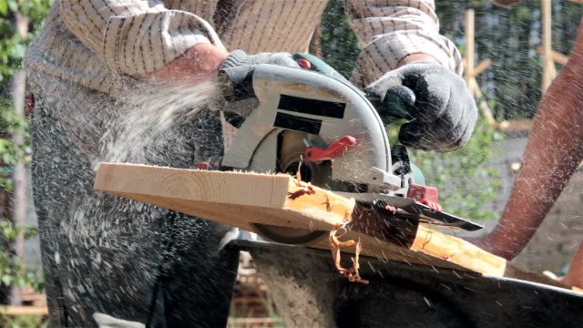 circular saw sawing a plank. - timber stock videos and b-roll footage