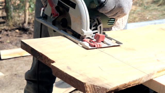 circular saw sawing a plank. - plank stock videos & royalty-free footage