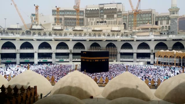 circumambulation (tawaf) around the kabah (al haram mosque) is carried out or in progress - hajj stock videos & royalty-free footage