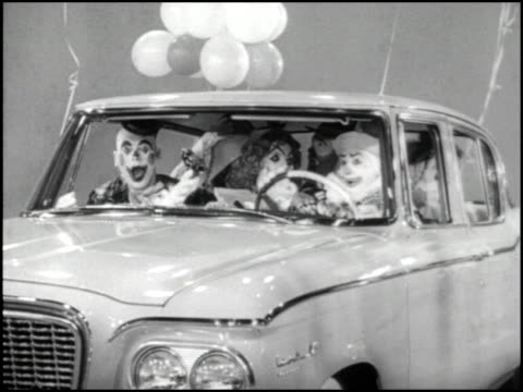 / circus clowns are used to illustrate the roomy comfort offered in all 1961 studebaker larks 1961 studebaker lark tv commercial clowns on september... - curious cumulus productions stock videos and b-roll footage