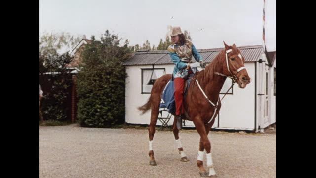 vídeos de stock, filmes e b-roll de montage circus performer practices horse riding in united kingdom - montar um animal