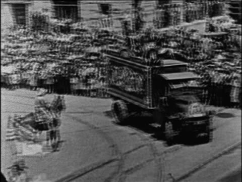 b/w 1928 circus truck turning on city street as crowd watches / documentary - 1928 stock videos & royalty-free footage