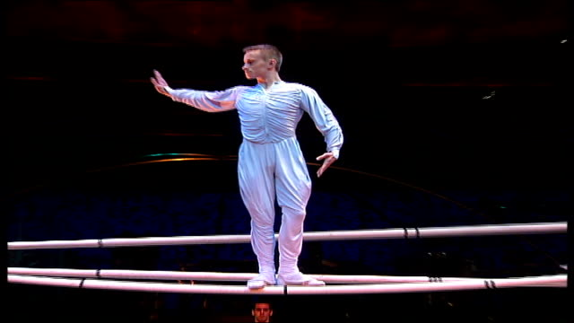 cirque du soleil return to albert hall; alexei liubezny climbing up series of poles sasha moisee giving instructions alexei liubezny somersaulting... - narrow stock videos & royalty-free footage