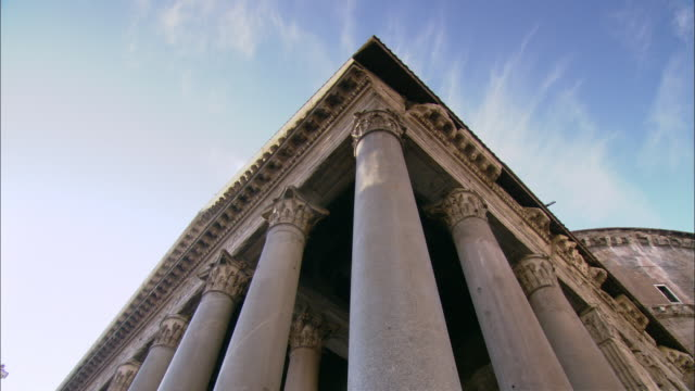 cirrus clouds float above the corinthian columns of the pantheon in rome, italy. - pantheon rome stock videos and b-roll footage