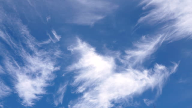 cirrus clouds on blue sky. - wispy stock videos and b-roll footage