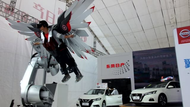 citizen experiences dongfeng nissan vr wingsuit flying during an auto show on september 20 in yichang, hubei province of china. - cyberspace stock videos & royalty-free footage