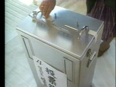 citizen of japan places a ballot in a ballot box during an election. - (war or terrorism or election or government or illness or news event or speech or politics or politician or conflict or military or extreme weather or business or economy) and not usa点の映像素材/bロール
