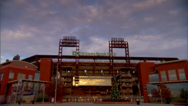 citizens bank park third base gate sunlight reflecting off stadium sidewalk street partial metal gate fg sports baseball phillies arena - philadelphia phillies stock videos and b-roll footage