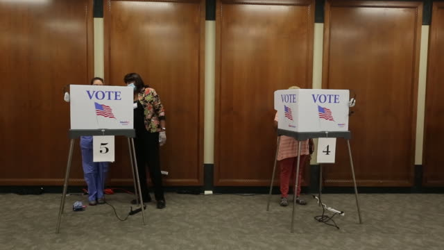 citizens giving their votes in voting booths. footage of people waiting in line and casting ballots at polling locations during in-person absentee... - south carolina stock videos & royalty-free footage