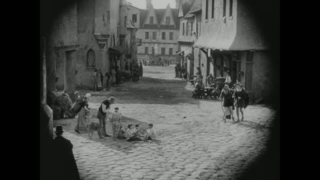 1572 citizens go about their days in a french village - loaf of bread stock videos & royalty-free footage