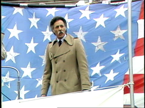 citizens lobby for a u.s./soviet nuclear weapons freeze rally on u.s. capitol building stairs. u.s. house representative ron dellums standing on... - トレンチコート点の映像素材/bロール