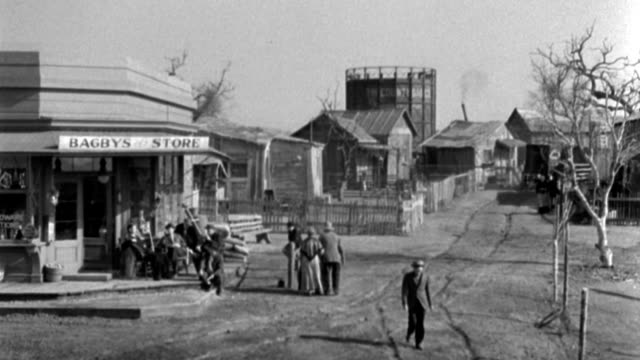citizens of a small town gather in front of a store. - 1934 stock videos & royalty-free footage