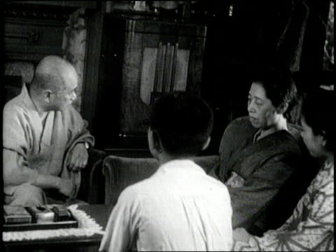 citizens of japan react with sadness as emperor hirohito announces the japanese surrender on august 15 1945 - arrendersi video stock e b–roll