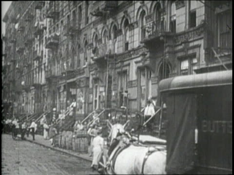 citizens of manhattan make purchases from street vendors - 1910 stock-videos und b-roll-filmmaterial