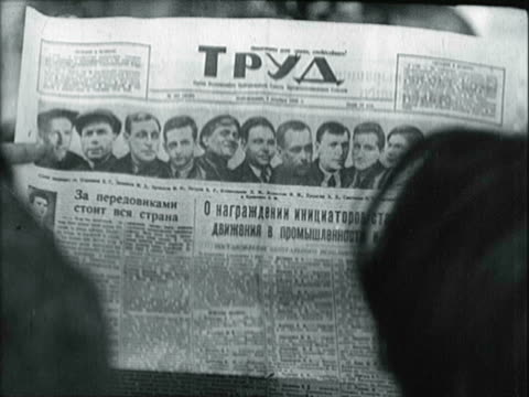 citizens reading soviet russian newspaper, specifically article about stakhanov / alexei stakhanov drinking, laughing, celebrating with guests - male likeness stock videos & royalty-free footage