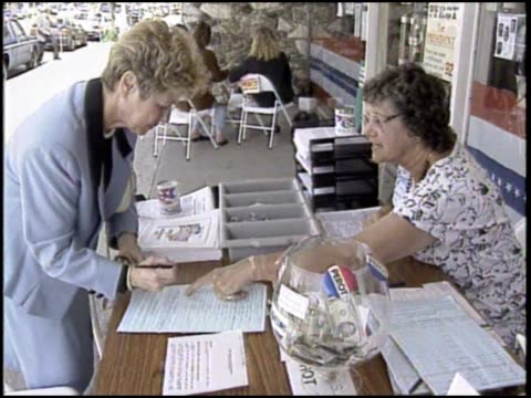 citizens register to vote for ross perot at the candidate's headquarters - 1992 stock videos & royalty-free footage