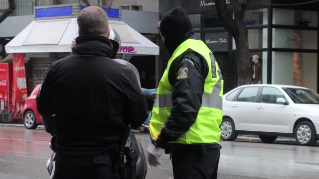 citizens strollers bikers and all the people who are outside of their houses are checked by the police officers with face mask and gloves for the... - thessalonika stock videos & royalty-free footage