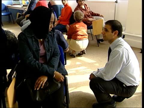 immigrants face tests lunchtime england london students attending adult english class cms writing on board cms home secretary david blunkett talking... - 市民点の映像素材/bロール