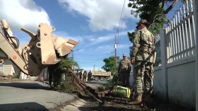 citizensoldiers of the puerto rico army national guard clear roads at ingenio in toa baja puerto rico - national guard stock videos and b-roll footage