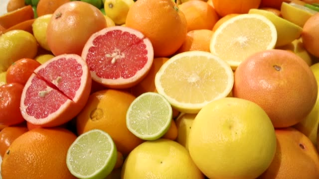 citrus fruits including limes, oranges, grapefruit and lemons lie on display at the 2018 international green week agricultural trade fair on january... - citrus fruit stock videos & royalty-free footage