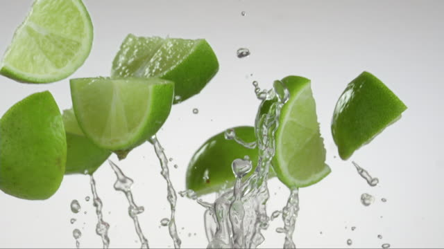 citrus lime flying and creating splashing droplets