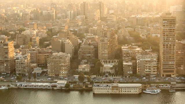 stockvideo's en b-roll-footage met ms city along the nile river at sunset/ cairo/ egypt - caïro