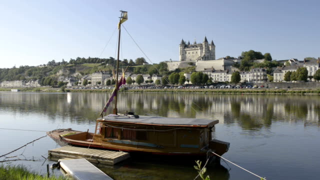 City and Castle of Saumur along the Loire river and houseboat