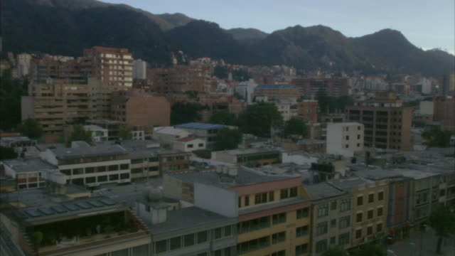 ha ws pan city apartment buildings and surrounding hillside / bogota, colombia - bogota stock videos & royalty-free footage