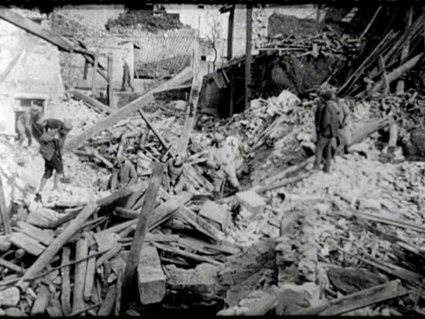 / city architect max saintsaulieu looks at a stained glass window / soldiers who are digging in a massive pile of rubble / unexploded shell still... - sidecar stock videos & royalty-free footage