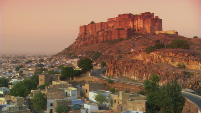 ws, city below mehrangarh fort at sunset, jodhpur, rajasthan, india - fortress stock videos and b-roll footage
