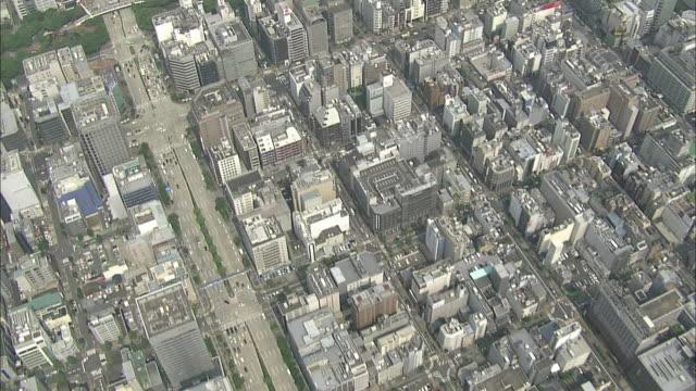 City blocks filled with high-rises border a long park in Nagoya, Japan.