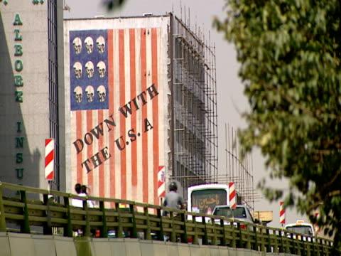 la city building with graphic noting dislike for america / tehran, tehran, iran - iran stock videos & royalty-free footage