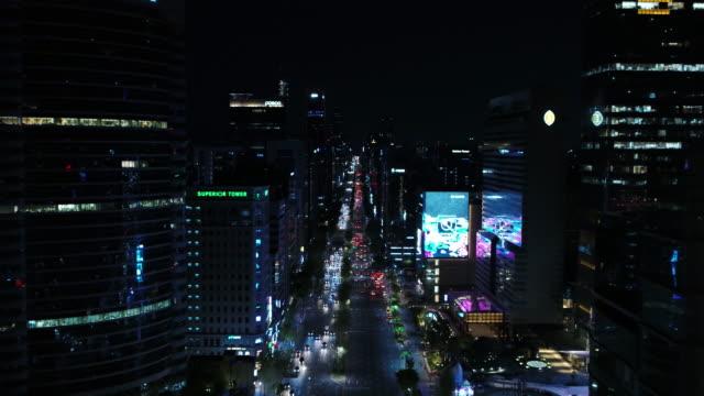 city buildings along teheran-ro road at night / gangnam-gu, seoul, south korea - billboard stock videos & royalty-free footage