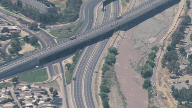 vídeos y material grabado en eventos de stock de 2010 aerial city buildings and roads / santiago de chile, gran santiago, chile - camino santiago
