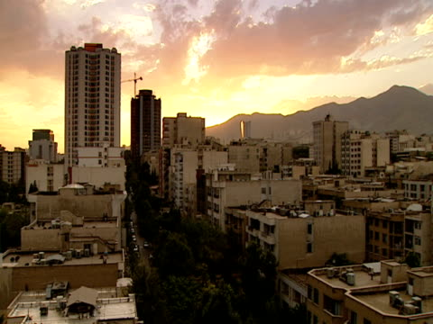 ha city buildings and rooftops at sunset / tehran, tehran, iran - tehran stock videos and b-roll footage