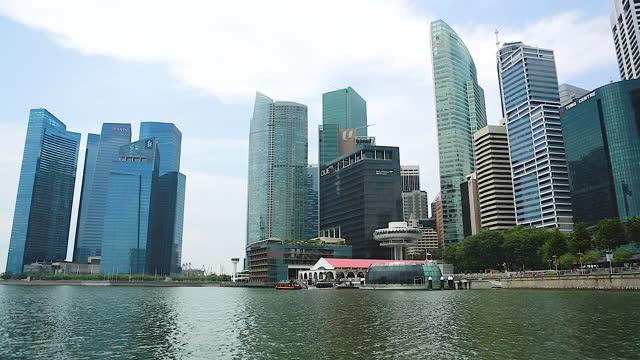 city buildings near marina bay sands hotel / singapore - singapore stock videos & royalty-free footage
