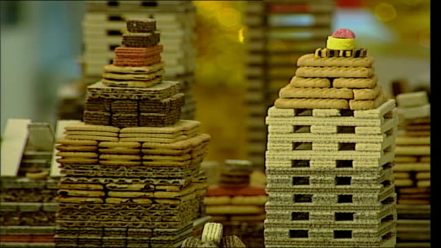 city built from biscuits on display at selfridges england london selfridges int general views piles of biscuits modelled in the shape of buildings on... - wafer stock videos and b-roll footage