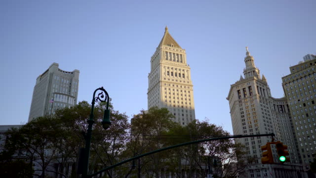 city business buildings district. modern high rise metropolis skyline cityscape - vägsignal bildbanksvideor och videomaterial från bakom kulisserna