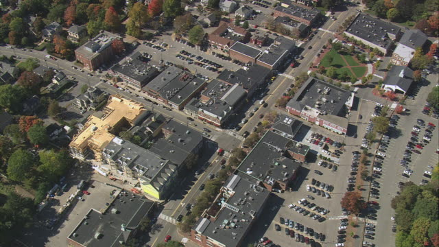 aerial city center, rooftops, parking lots, vehicles, and commercial buildings in cityscape / lexington, massachusetts, united states - lexington massachusetts stock videos & royalty-free footage