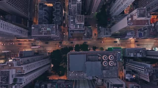 stockvideo's en b-roll-footage met city centre traffic at night in hong kong island central. aerial drone view - hong kong