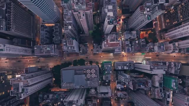 city centre traffic driving inhong kong island central at night. aerial drone view - concept stock videos & royalty-free footage