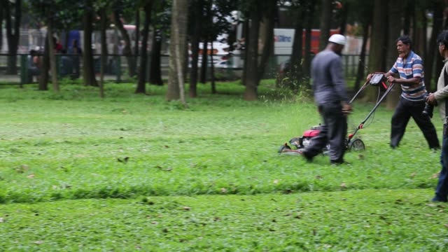 City corporation worker clean park in Dhaka Bangladesh on May 08 2018
