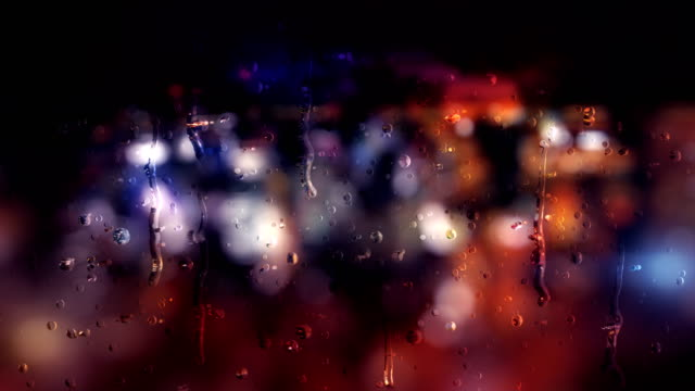 city defocused lights behind raindrops - condensation stock videos & royalty-free footage