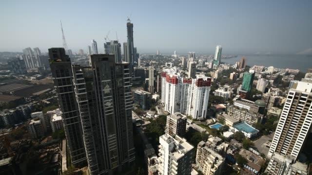 aerial a city district full of skyscrapers / india - インド点の映像素材/bロール